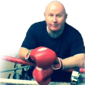 Martin Paradine in the boxing ringwith gloves on ready!