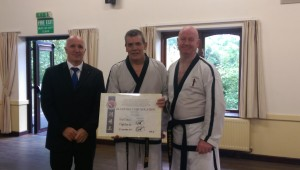 Awarding Mr Sekulic his 5th Dan Black belt.